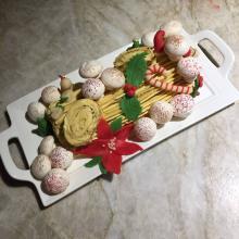 Bûche de Noël with meringue mushrooms and marzipan decorations