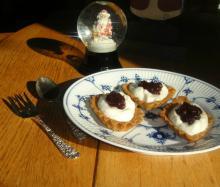 Sandbakkels, whipped cream, and lingonberry jam